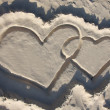 图库照片: Two sand hearts on beach
