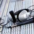 Headphones on sound mixer - Stock Photo