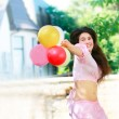 Happy girl with colorful balloons — Stock Photo #12618598