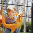 Stock Photo: Swinging baby boy