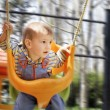 Swinging baby boy - Stock Photo