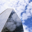 Skyscraper with sky reflection — Stock Photo