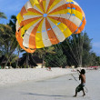 Paragliding on sand beach — Stock Photo