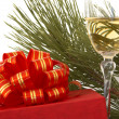 Stock Photo: Gift box and glass of champagne over white