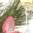Stock Photo: Jewelry gift and glass of champagne over white
