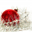 Christmas ball and tinsel over white — Stock Photo