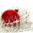 Christmas ball and tinsel over white - Stockfoto