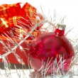Gift box, xmas ball and tinsel over white — Stock Photo