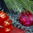 Gift box, christmas ball and tinsel — Stock Photo #12618886