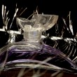 Bottle of perfume over black - Foto de Stock
