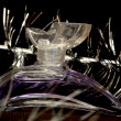 Bottle of perfume over black - Foto Stock