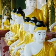 Budda statues in buddist temple - Stock Photo