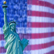 Statue of liberty on usa flag backgorund - Stock Photo
