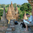 Tourist reading map on temple background - Stock Photo