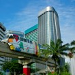 Monorail on skyscrapers background — Stock Photo