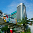 Monorail on skyscrapers background - Stock Photo