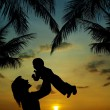 Stock Photo: Silhouette of mother and son at sunset in tropics