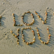 """I love you"" from seashells on sand beach — Stock Photo"