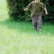 Happy boy running on natural background — Stock Photo #12619498