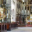 Cathedral interior with altar and seats - Stok fotoğraf