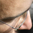 Close up of eye and glassses - Stock Photo