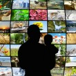 Father and son looking at tv screens showing beauty in nature — Stock Photo