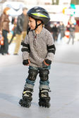 Young boy rollerskating in city — Stock Photo