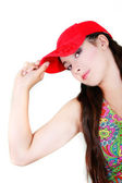 Attractive girl in red cap over white — Stock Photo