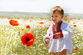 Young boy in traditional clothes on natural background — Stock Photo