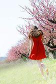 Young girl in spring garden — Stock Photo