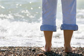 Female feet on sea background — Stock Photo