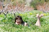 Happy girl in green grass — Stock Photo