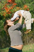 Pregnant woman with toddler son — Stock Photo