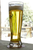 Glass of beer on street cafe terrace background — Stock Photo