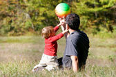 Father and son playing outdoors — Stock Photo