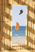 Two kites in the sea, view through window — Foto Stock