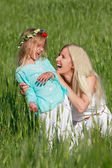 Happy mother and daughter outdoors — Stock Photo