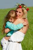 Loving mother and daughter on nature — Foto Stock