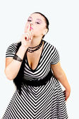 Pin up girl with finger at her lips over white — Stock Photo