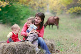 Mother playing with two kids on nature — Stock Photo