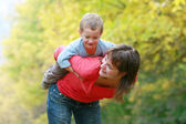 Happy mother playing with son outdoors — Stock Photo