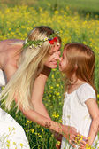 Loving mother and daughter on nature — Stock Photo
