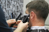 Male barber at work — Stock Photo