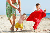 Happy family on beach — Stock Photo