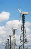 Wind turbines over sky — Stock Photo