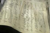 Music noted through white gauze — Stock Photo