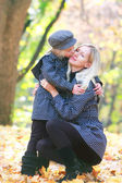 Loving mother and daugther in autumn park — Stock Photo