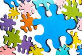 Colorful puzzles over white — Stockfoto