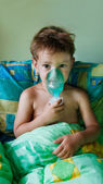 Close up of child making inhalation — Stock Photo