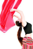 Girl dancing with red scarf over white — Stock Photo
